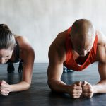 Two people doing plank