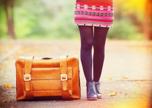 Woman with packed bags