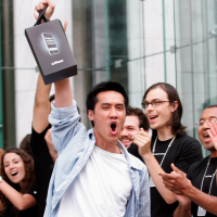 Happy man with new iPhone