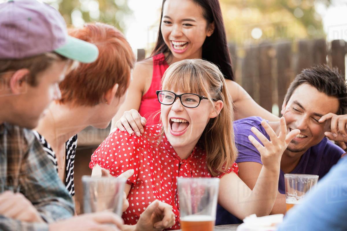 6 friends talking at picnic table