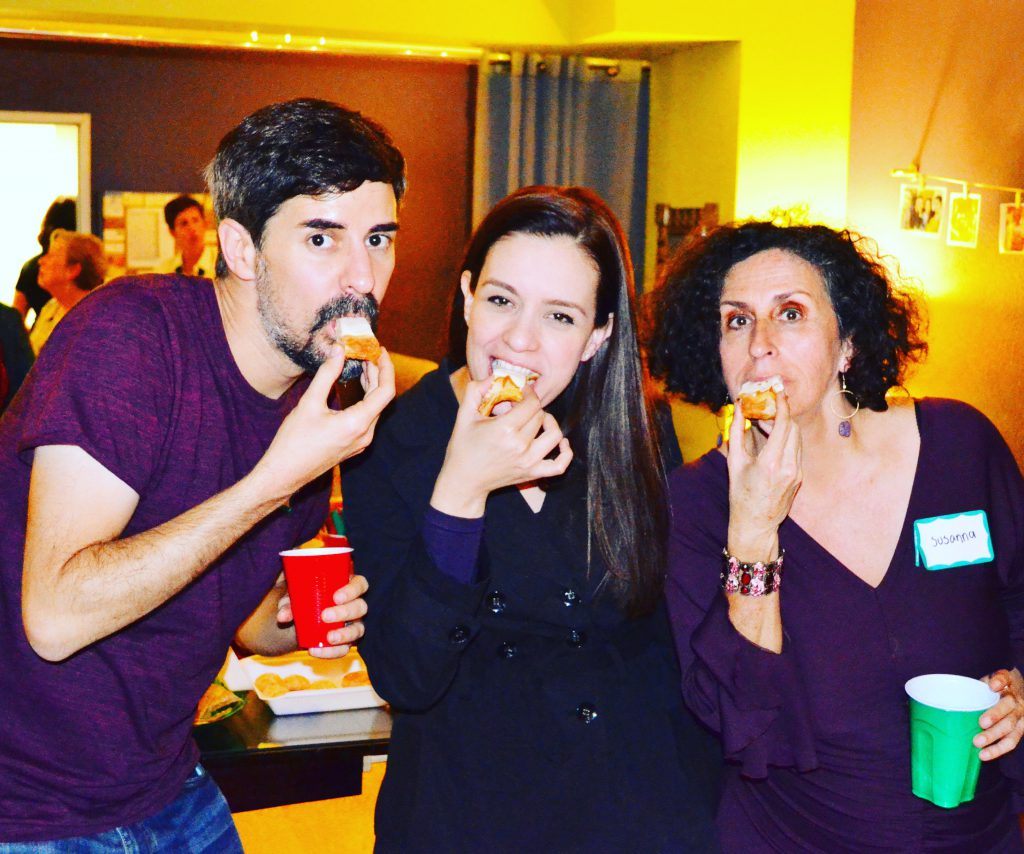 3 people biting into a canape